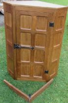 Wilf Squirrel Man Hutchinson, an oak corner cabinet, with panelled door, width 27.5ins, height 36.