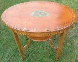 An Edwardian satinwood oval occasional table, decorated to the top and frieze with putti and