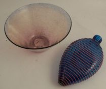 A glass bowl, of trumpet form, diameter 7ins, together with a blue glass flask with red circle