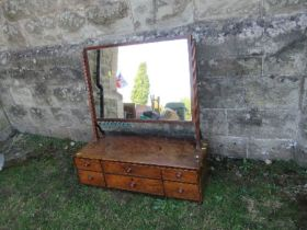A large 19th century mahogany swing frame toilet mirror, the base fitted with two long central