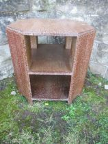 A 1930's Art Deco Heals octagonal limed oak book table, stamped number to base