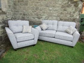 A two seat sofa, together with a single armchair, in grey upholstery, with fire labels