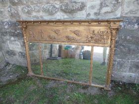 A Regency design triple plate mirror, the gilded frame having classical decoration, width 55ins x