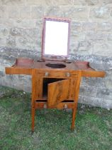 A 19th century mahogany folding pot cupboard / dressing table, the top opening to reveal apertures