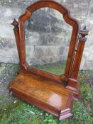 A Victorian figured walnut toilet mirror, having kingwood banding and obelisk shaped supports, and