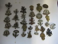 A quantity ofBritish Infantry Regiments of the Line Cap Badges, to include Middlesex, North and