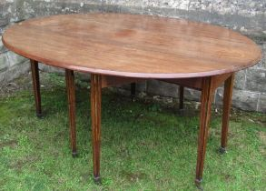 A Georgian mahogany drop leaf wake table, fitted with an end drawer to one end, raised on eight