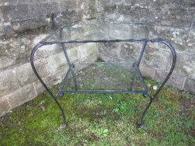 A Bromsgrove Guild glass top table, with wrought iron base, 18ins x 24ins x height 25ins