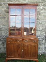 A 19th century design mahogany glazed cabinet, the upper section having glazed doors opening to