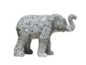 Spark-Ele An elephant calf sculpture, covered in small white, mirrored and shiny mosaic tiles H730mm