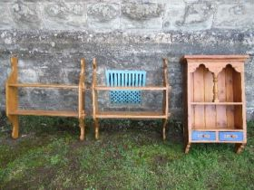 A hanging pine cabinet, width 19ins, together with two hanging sets of shelves, width 27ins
