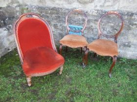 A 19th century easy chair, raised on turned front legs, together with a pair of Victorian hoop