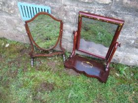 Two swing frame toilet mirrors, one with painted floral decoration