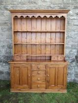 A pine dresser, with plate rack over, width 70ins x depth 16ins x height 84ins