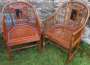 Two Oriental design bamboo effect armchairs, with lacquered panel and cane seats