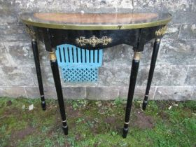 A painted console table, with inlay decoration and applied metal mount, one leg broken, width