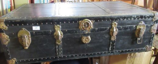 A black trunk, with brass corners, 40ins x 23ins x 12ins