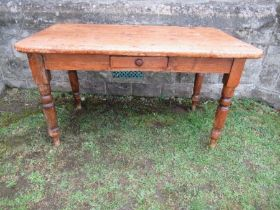 A pine kitchen table, 50ins x 30ins x height 28ins