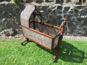 A Victorian mahogany and bergere framed cot, damage to the cane, maximum height 44ins x length