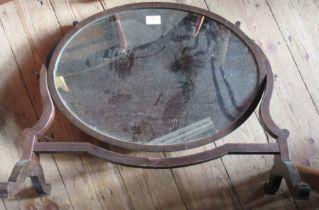 An oval mahogany framed dressing table mirror