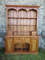 A pine dresser, with arcaded upper section, width 70ins x depth 16ins x height 84ins