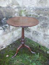 A Georgian dish top oak tripod table, diameter 19ins x height 26ins