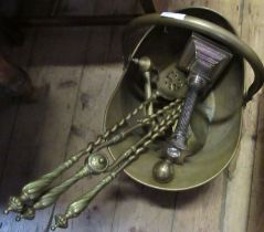 A brass coal scuttle, together with fire tools, andiron and a candlestick