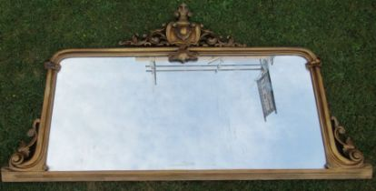 A gilt framed over mantel mirror, of rectangular form, with scroll and leaf decoration, overall