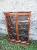 A Georgian design glazed cabinet, the astragal glazed doors opening to reveal shelves, width 34ins x