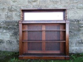 A Victorian rosewood set of shelves, with mirror above, adjustable shelves, width 43ins x depth 8ins