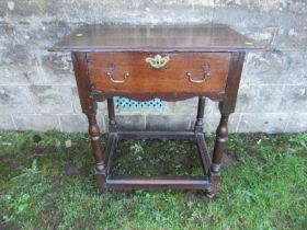 An antique oak side table, fitted with a single drawer, width 27ins x depth 18.5ins x height 29ins
