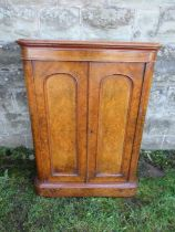 A Victorian burr walnut specimen cabinet, the doors opening to reveal eight adjustable trays over