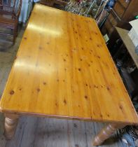 A large pine kitchen table, 84ins x 47ins, height 30ins