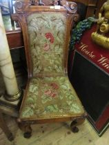 A Victorian carved chair, with tapestry seat and back