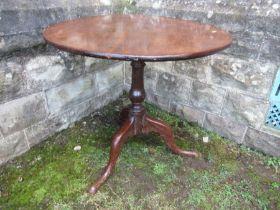 A 19th century oak tilt top tripod table, diameter 31ins x height 28ins