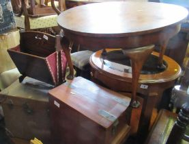 A circular coffee table, together with a trunk, a magazine rack and a mahogany box with coat of arms