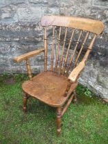 A kitchen armchair, with spindle back
