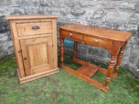 A pine cabinet, having cupboard door below a drawer, width 27ins x depth 14ins x height 39ins,