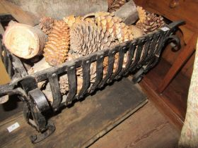 A cast iron fire grate, of rectangular form with scroll decoration, 26ins x 14ins, height 17ins