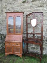 An oak bureau bookcase, width 30ins x height 80ins, together with a hall stand, and a serpentine
