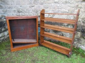An Arts and Crafts style set of oak shelves, width 39ins x height 49ins, together with a mahogany