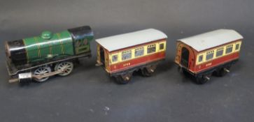 A Hornby Clockwork Tinplate Train Set in working order. Train missing chimney and carriages sun-