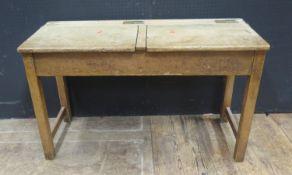 A Twin School Desk, the brass inkwell slides stamped Andrew Bentley Ltd., 101cm diam.