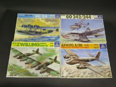 Four Italeri WWII German War Plane Kits 1/72 Scale. No. 111, 122, 117, 119. Appear unmade,