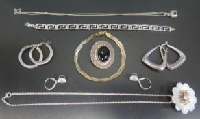 A Sterling Silver Gilt Bracelet, silver and mother of pearl pendant brooch on chain and other silver