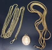 A Gilt Metal Locket and two guard chains