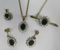 A Pair of 9ct Gold, Sapphire and White Stone Earrings, Brooch and two Pendants with one on a