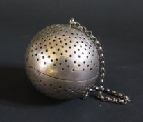 An Antique White Metal Infuser on chain, 5.5cm diam., 41g