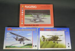 Two AML Heinkel German War Plane Kits and One Flugzeug Heinkel 1/72 Scale. Appear unmade, complete