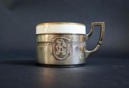A German .800 Silver Cup and Saucer with porcelain liner, 134g